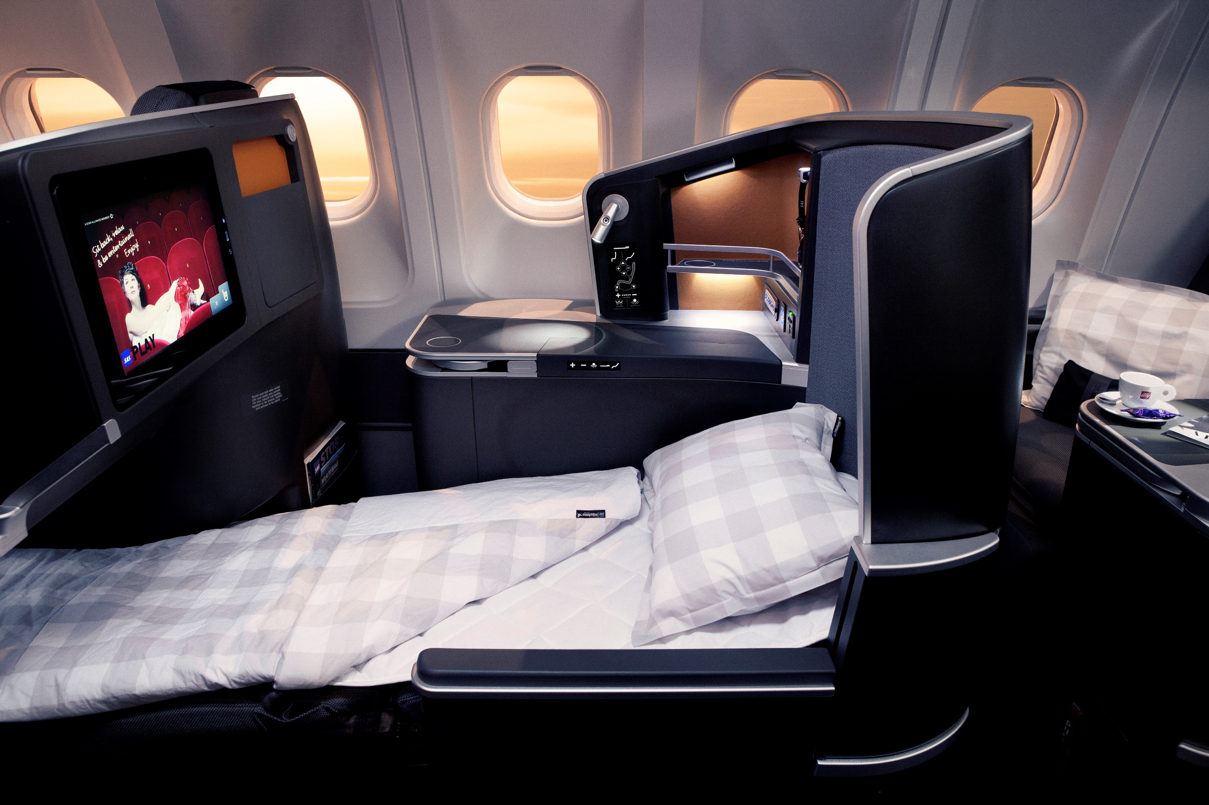 New a330 business class features h 228 stens bedding and a snack bar