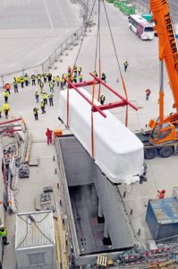 Munich Airport_new satellite terminal_13 March 2015 The undergorund Passenger Transport System is lifted into place