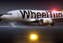 WheelTug in action, showing safety lights in nosewheel